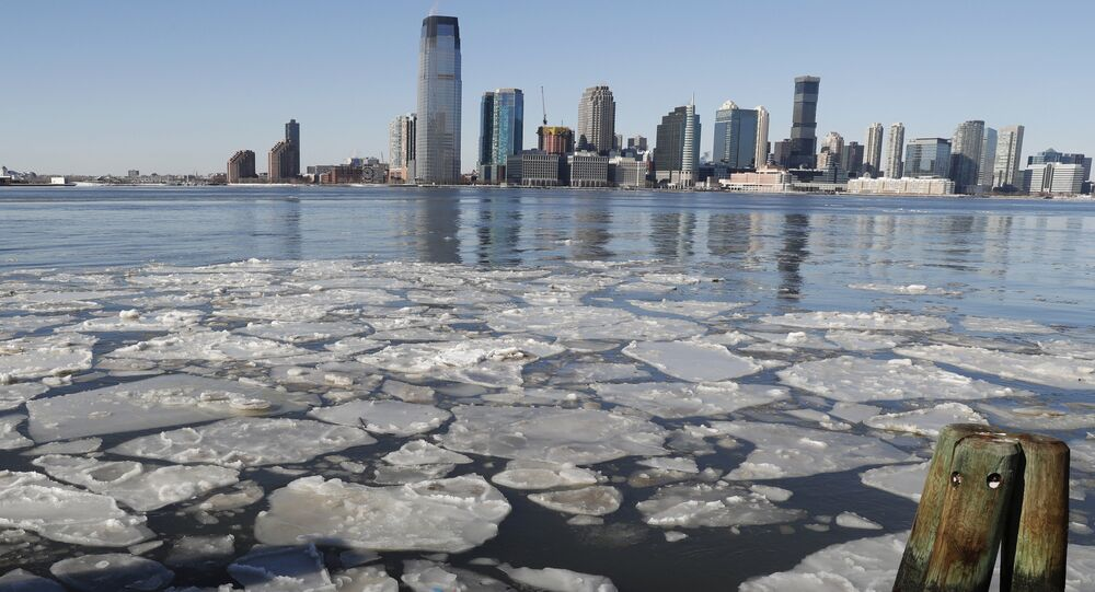 Ice floats in the Hudson River in Lower Manhattan with Jersery City, N.J., visible across the river, Sunday, Jan. 7, 2018, as bitterly cold temperatures continued through the weekend in New York