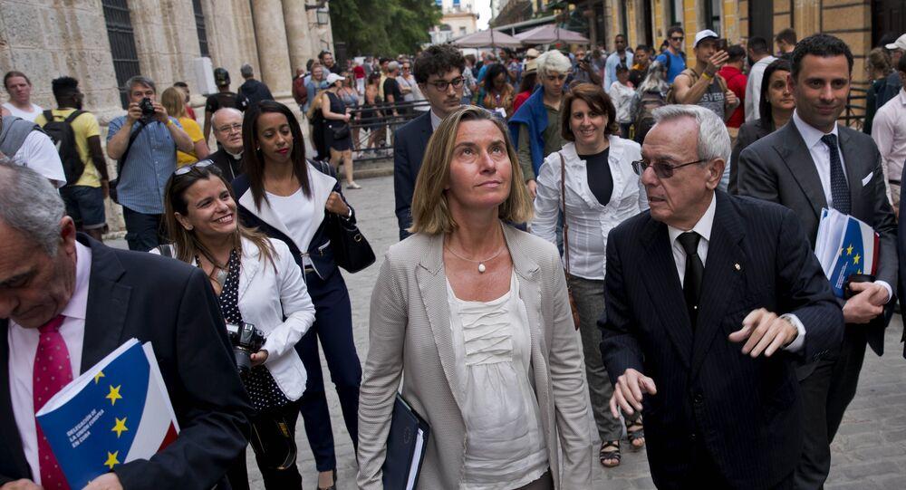 European Union High Representative Federica Mogherini, center, listens to Cuba's historian Eusebio Leal, right, as she tours Old Havana, Cuba, Wednesday, Jan. 3, 2018