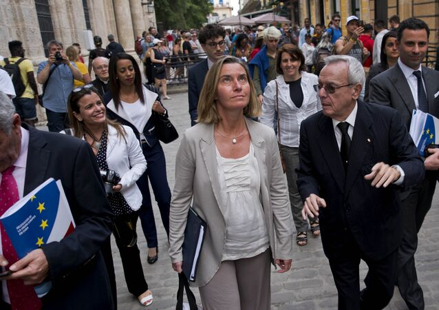European Union High Representative Federica Mogherini, center, listens to Cuba's historian Eusebio Leal, right, as she tours Old Havana, Cuba, Wednesday, Jan. 3, 2018