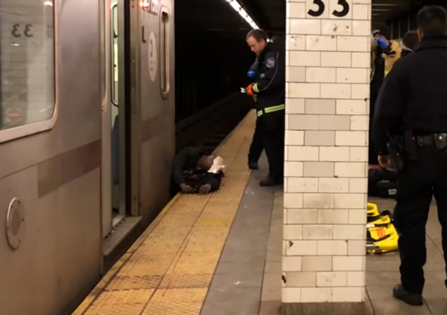 Man rescued by official after getting pinned between a NYC subway train and platform