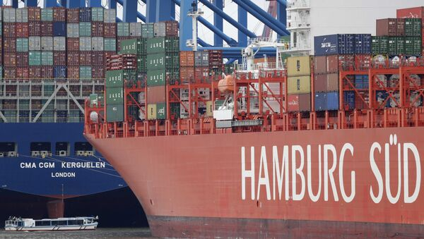 Shipping containers are stacked on a ship in the port in Hamburg, Germany (File). - Sputnik International