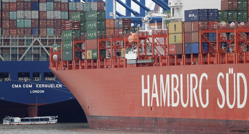 Shipping containers are stacked on a ship in the port in Hamburg, Germany (File)