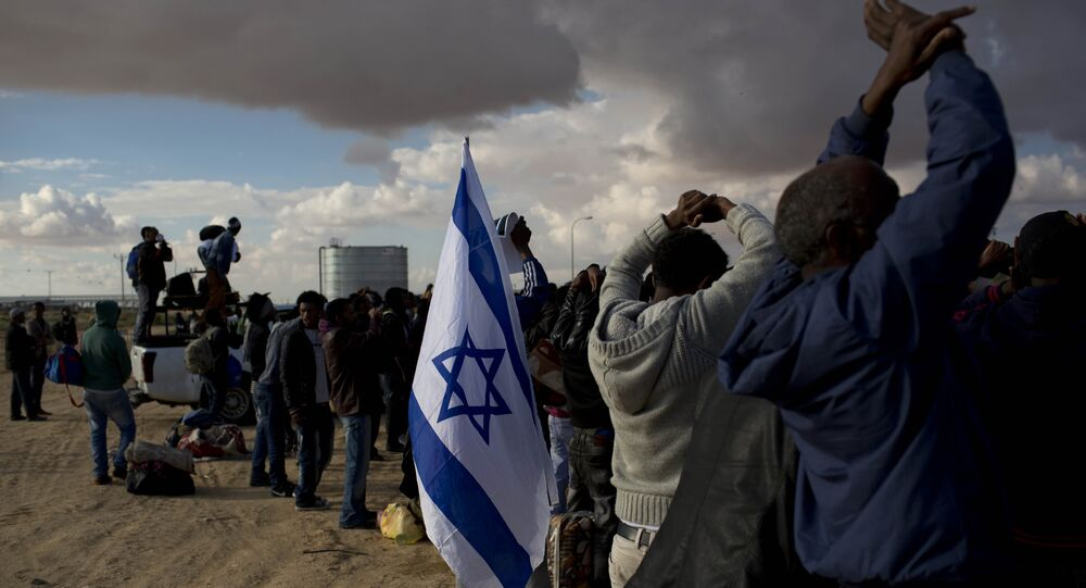 African migrants protest outside Holot detention center against the detention center near Ktsiot the Negev Desert in southern Israel.