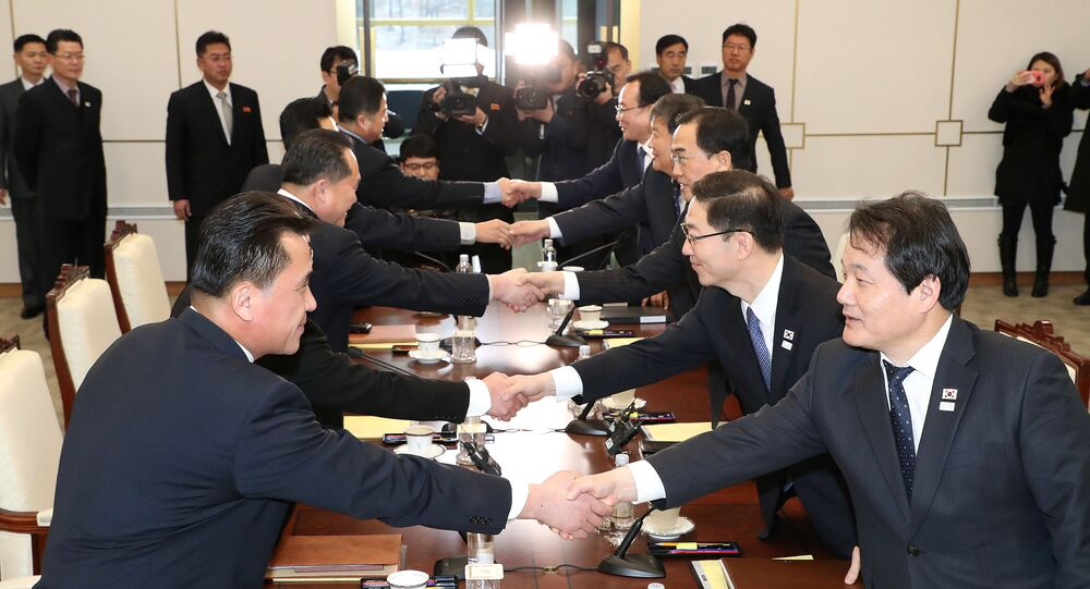 South and North Korean delegations attend their meeting at the truce village of Panmunjom in the demilitarised zone separating the two Koreas, South Korea, January 9, 2018