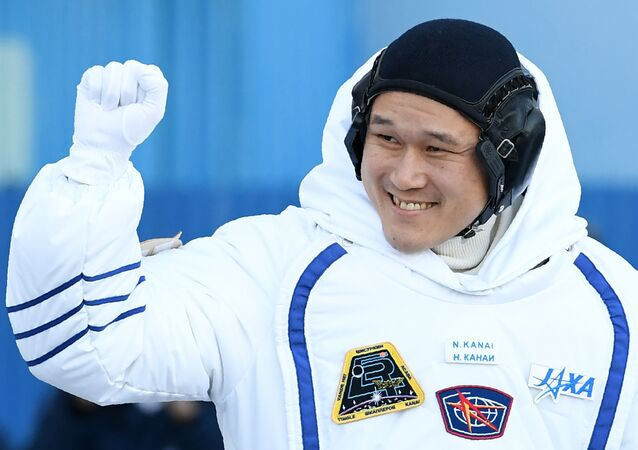 Member of the International Space Station (ISS) expedition 53/54, Norishige Kanai of the Japan Aerospace Exploration Agency (JAXA), waves during a send-off ceremony at the Russian-leased Baikonur Cosmodrome in Kazakhstan. (File)