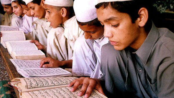 Indian Muslim children read the holy Quran at a madarsa, or institute of Islamic education, in Jammu, India (File) - Sputnik International