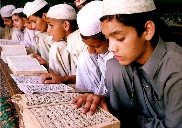 Indian Muslim children read the holy Quran at a madarsa, or institute of Islamic education, in Jammu, India (File)