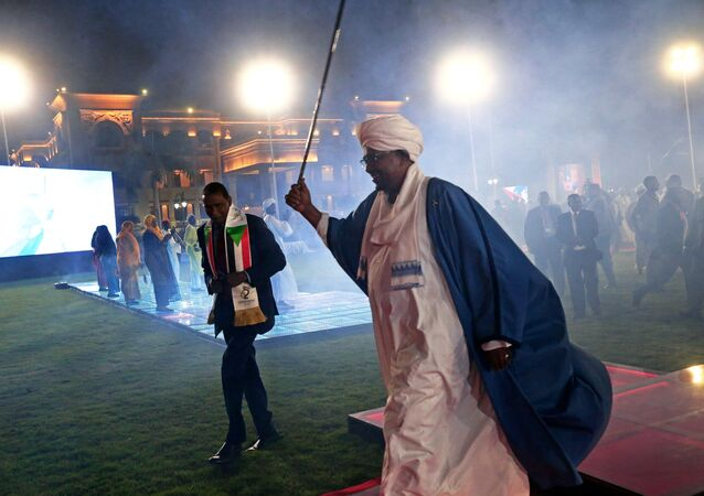 Sudan's President Omar Al Bashir waves after address the nation during the 62nd Anniversary Independence Day at the Palace in Khartoum, Sudan December 31,2017