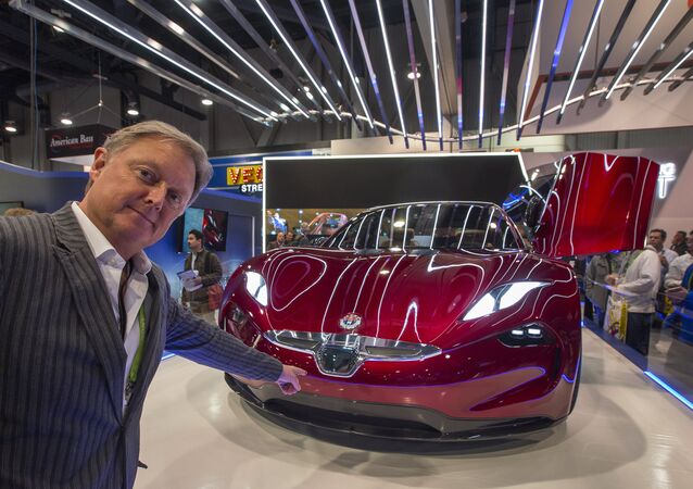 Henrik Fisker, founder, Chairman and CEO of Fisker Inc., speaks next to a Fisker EMotion all-electric vehicle that uses LiDAR technology at CES in Las Vegas, Nevada