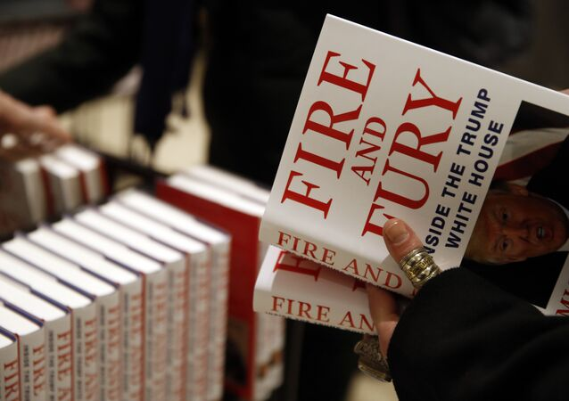 A customer looks at a copy of Michael Wolff's Fire and Fury: Inside the Trump White House as they go on sale at a bookshop, in London, Tuesday, Jan. 9, 2018.