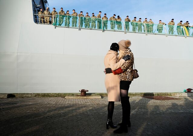 Relatives wave goodbye to soldiers aboard the Danish Warship Esbern Snare which leaves for Estonia from Korsoer naval base, carrying infantry fighting vehicles in Denmark January 9, 2018