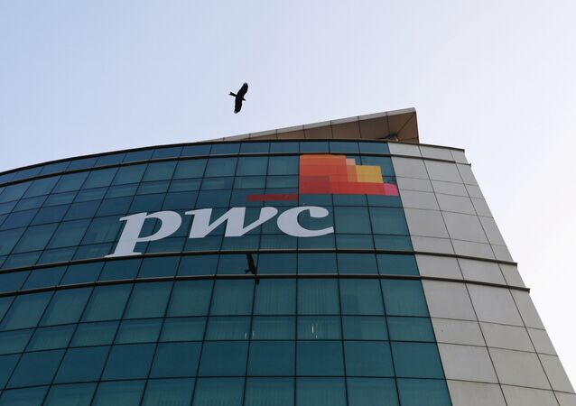 A bird flies past the logo of Price Waterhouse installed on the facade of its office in Mumbai, India, January 11, 2018