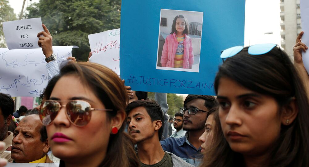 People hold signs to condemn the rape and killing of a 7-year-old girl Zainab Ansari in Kasur, during a protest in Karachi, Pakistan