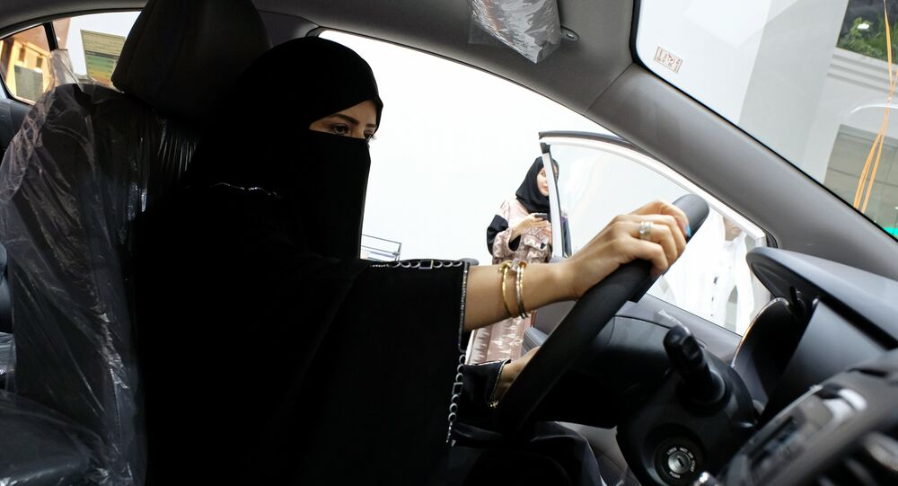 A Saudi woman checks a car at the first automotive showroom solely dedicated for women in Jeddah, Saudi Arabia January 11, 2018