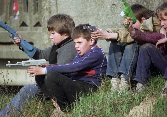 Children playing war. File photo