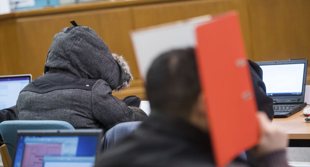 """(File) In this Nov. 9, 2016 file photo defendants wait for the start of the hearing in the district court in Wuppertal, Germany. A German federal court on Thursday Jan. 11, 2018 overturned the acquittal of seven men who posed as a self-styled """"Sharia police,"""" ordering a retrial on charges that they violated rules on wearing uniforms."""