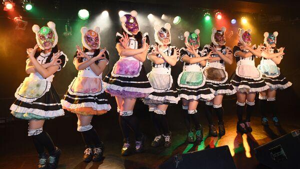 Female idol group Kasotsuka Shojo (Virtual Currency Girls), produced by Japanese idol agency Cinderella Academy, pose on stage in Tokyo - Sputnik International