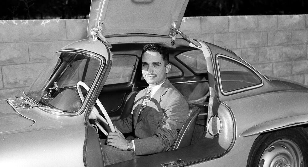 King Hussein of Jordan sits in his new Mercedes-Benz sports car at the Jordanian Royal Palace in Amman, Jordan, Oct. 30, 1957. The car is one of the latest models with gull-wing doors.