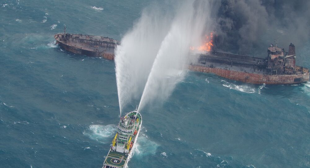 A rescue ship works to extinguish the fire on the stricken Iranian oil tanker Sanchi in the East China Sea, on January 10, 2018 in this photo provided by Japan's 10th Regional Coast Guard