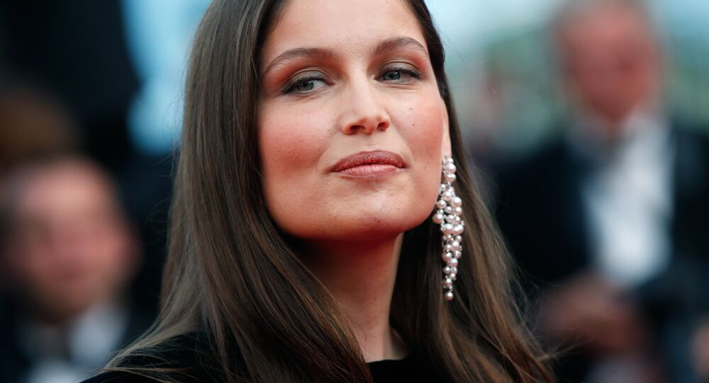 Actress Laetitia Casta poses for photographers upon arrival at the screening of the film The Meyerowitz Stories at the 70th international film festival, Cannes, southern France, Sunday, May 21, 2017