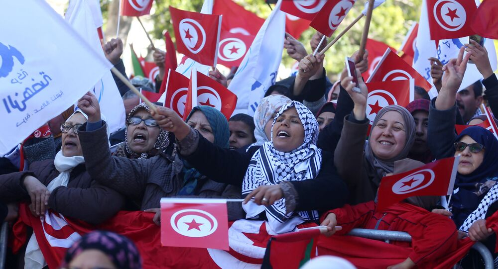 People wave national flags during demonstrations on the seventh anniversary of the toppling of president Zine El-Abidine Ben Ali, in Tunis, Tunisia January 14, 2018