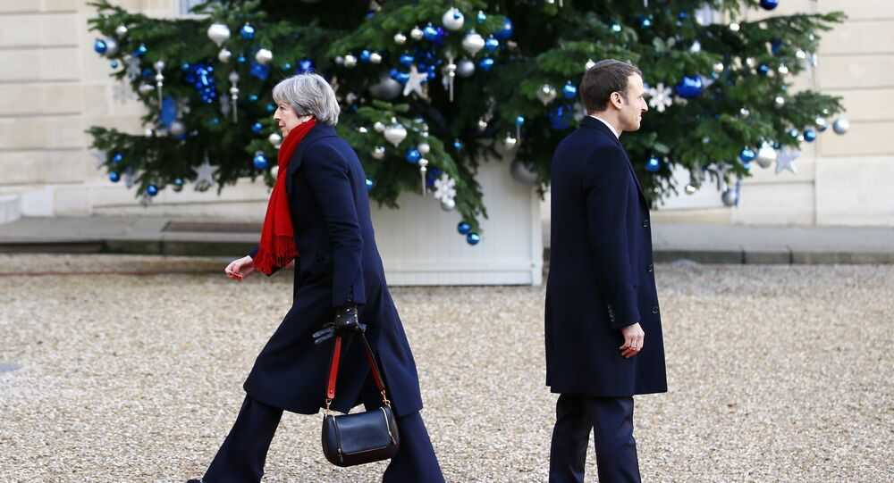 British Prime Minister Theresa May is welcomed by French President Emmanuel Macron before a lunch at the Elysee Palace in Paris, Tuesday, Dec. 12, 2017