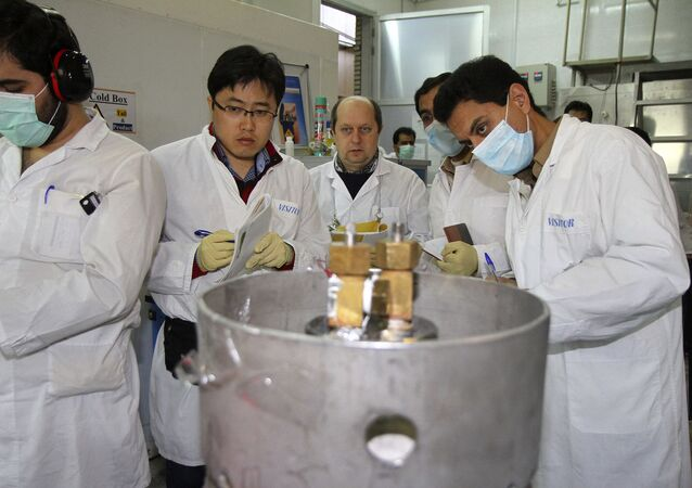 Unidentified International Atomic Energy Agency (IAEA) inspectors and Iranian technicians are on hand to cut the connections between the twin cascades for 20 percent uranium enrichment at Natanz facility, some 200 miles (322 kilometers) south of the capital Tehran, Iran, Monday, Jan. 20, 2014