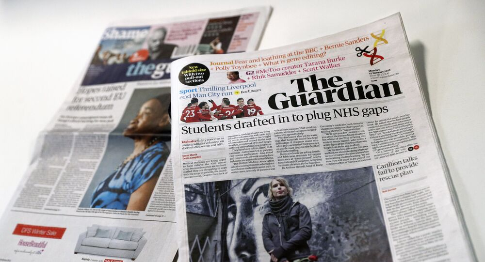 The new look tabloid Guardian is on show next to the old broadsheet version of the national newspaper on January 15, 2018