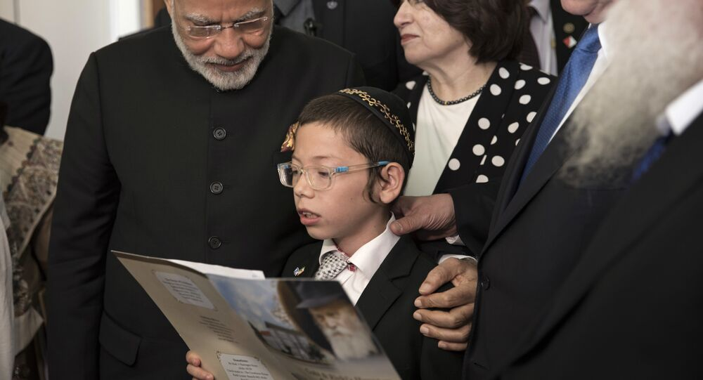 Indian Prime Minister Narendra Modi, left, with Israeli Prime Minister Benjamin Netanyahu, second right, meet with with Moshe Holtzberg, center, an Israeli boy, whose parents were killed in the Nov. 26, 2008 terrorist attack on the Mumbai Chabad House, at the King David Hotel in Jerusalem