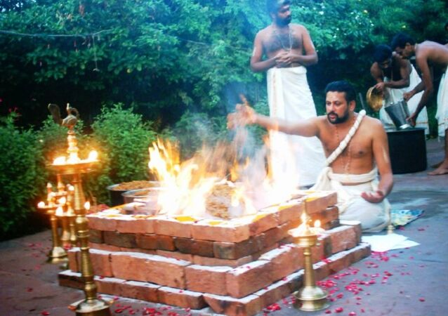 Yajurveda text describes formula and mantras to be uttered during sacrificial fire (yajna) rituals, shown