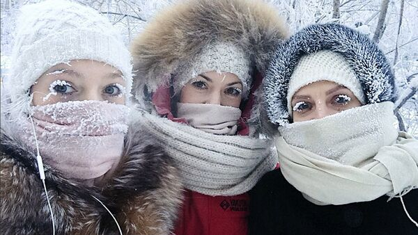 In this photo taken on Sunday, Jan. 14, 2018, Anastasia Gruzdeva, left, poses for selfie with her friends as the temperature dropped to about -50 degrees (-58 degrees Fahrenheit) in Yakutsk, Russia - Sputnik International