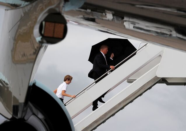 U.S. President Donald Trump and his son Barron board Air Force One as he departs West Palm Beach, Florida, U.S