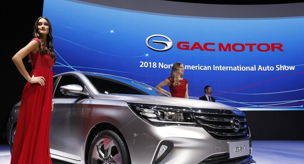 Models pose next to the 2019 GAC GA4 sedan after its unveiling at the North American International Auto Show in Detroit, Michigan, U.S., January 15, 2018