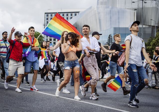People march during at the annual Gay Pride parade in central Stockholm on August 5, 2017