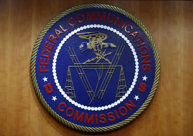 The seal of the Federal Communications Commission (FCC) is seen before an FCC meeting to vote on net neutrality in Washington. (File)