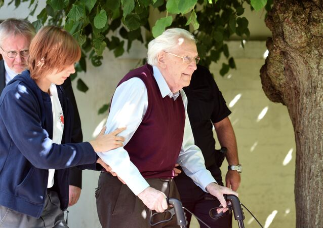 FILE PHOTO: Oskar Groening, defendant and former Nazi SS officer dubbed the bookkeeper of Auschwitz leaves the court after the announcement of his verdict in Lueneburg, Germany, July 15, 2015
