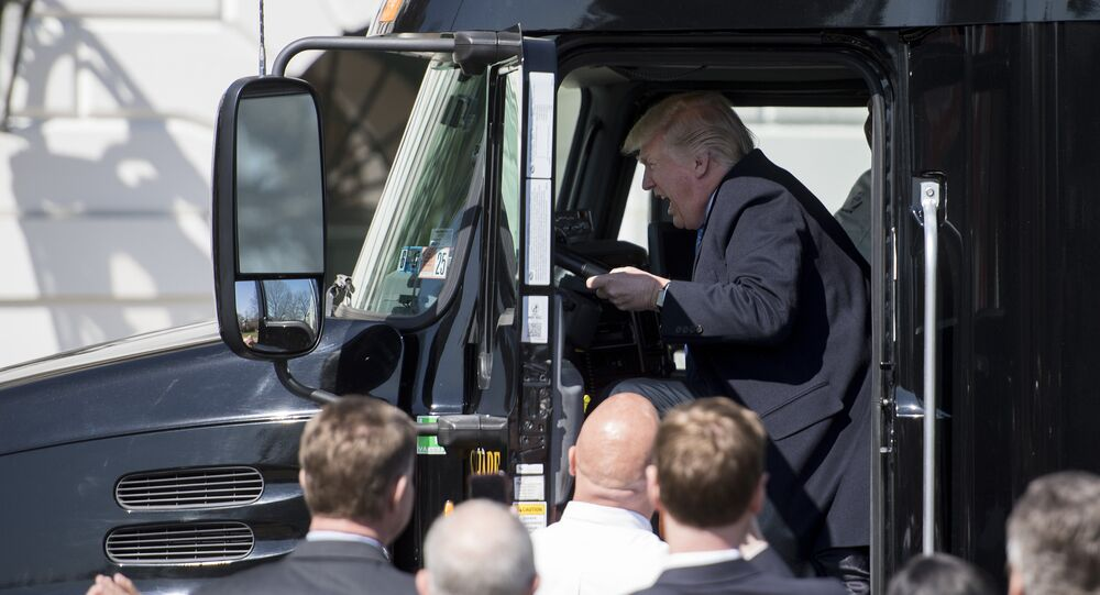 US President Donald Trump sits in the drivers seat of a semi-truck as he welcomes truckers and CEOs to the White House in Washington, DC, March 23, 2017, to discuss healthcare