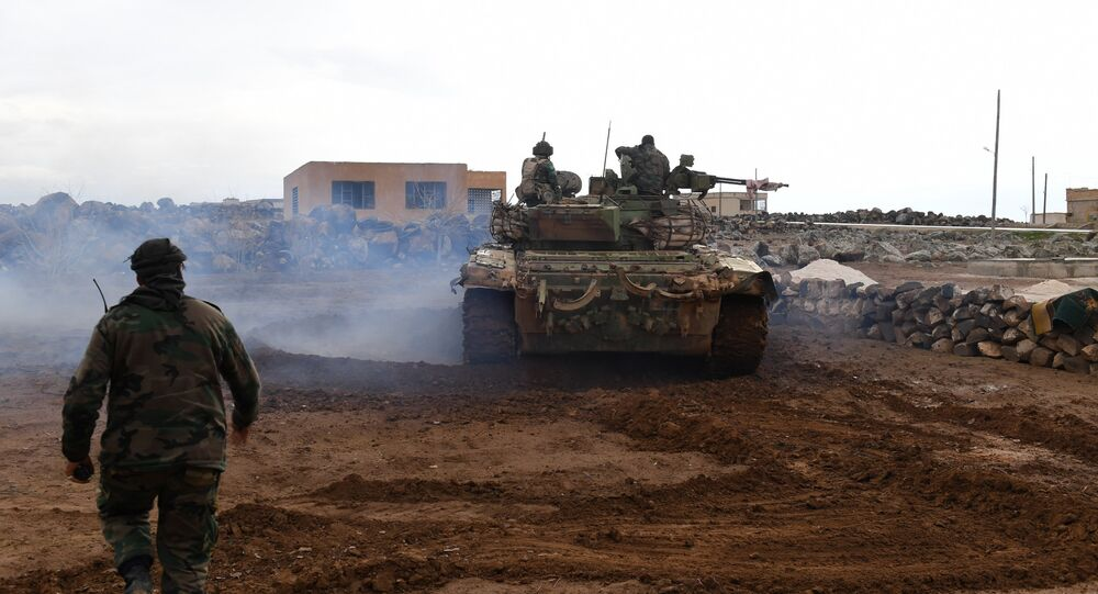 Syrian government forces gather in the village of Obeid, in the southern part of Aleppo province on January 18, 2018, as they advance towards the Abu Duhur military airport in the ongoing offensive against opposition fighters