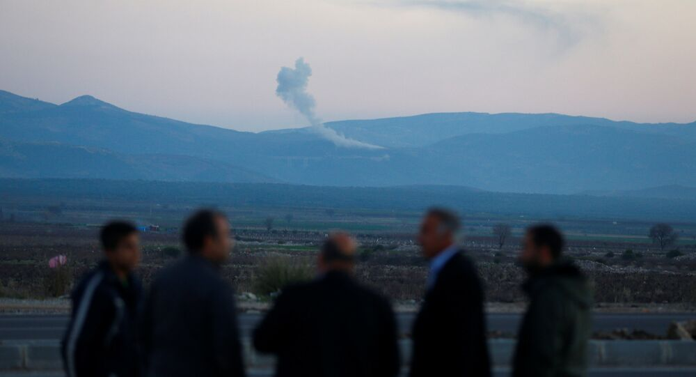 Smoke rises from the Syria's Afrin region, as it is pictured from near the Turkish town of Hassa, on the Turkish-Syrian border in Hatay province, Turkey January 20, 2018