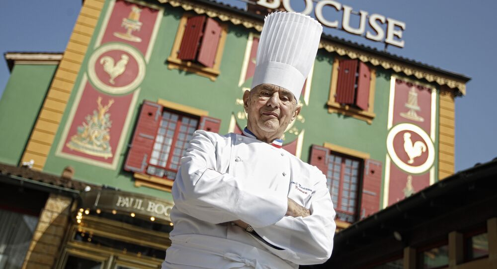 In this March 24, 2011 file French Chef Paul Bocuse poses outside his famed Michelin three-star restaurant L'Auberge du Pont de Collonges in Collonges-au-Mont-d'or, central France