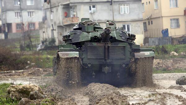 A Turkish army tank moves toward the Syrian border, in Reyhanlı, Turkey, Thursday, Jan. 18, 2018 - Sputnik International