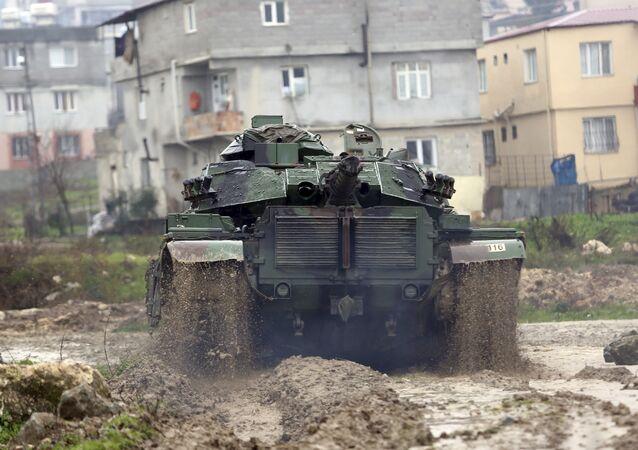 A Turkish army tank moves toward the Syrian border, in Reyhanlı, Turkey, Thursday, Jan. 18, 2018