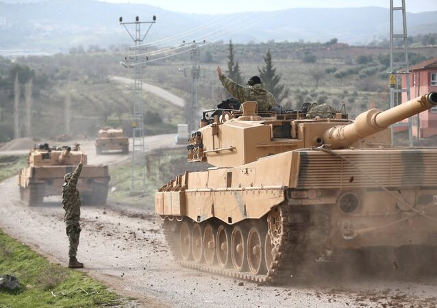 A Turkish military convoy arrives at a village on the Turkish-Syrian border in Kilis province, Turkey, January 21, 2018