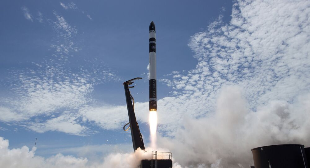 In this photo provided by Rocket Lab, Electron rocket carrying only a small payload of about 150 kilograms (331 pounds), lifts off from the Mahia Peninsula on New Zealand's North Island's east coast
