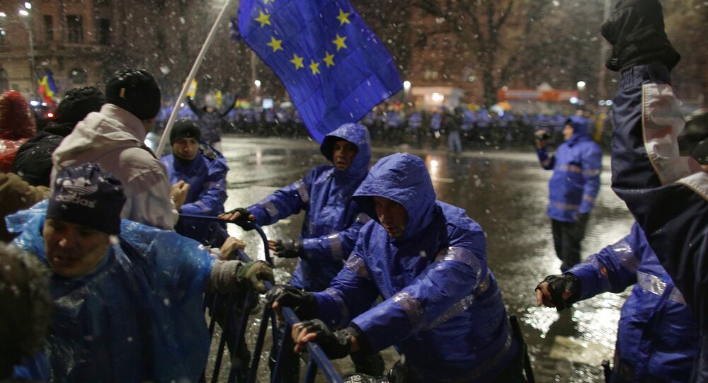 Protestors push barricades past police during a demonstration in Bucharest, Romania, January 20, 2018.