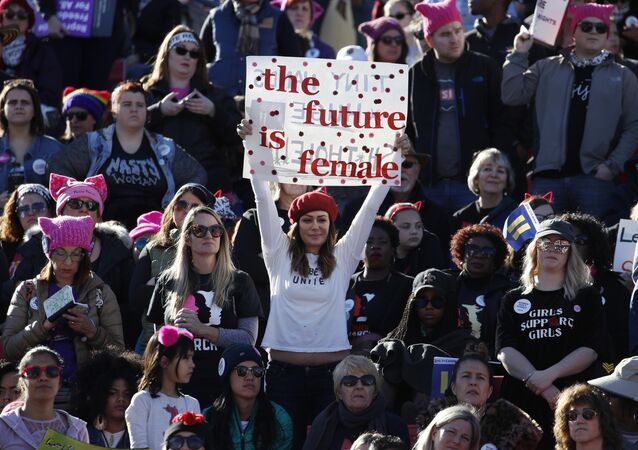 People cheer during a women's march rally Sunday, Jan. 21, 2018, in Las Vegas.