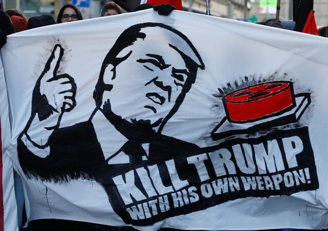 Protesters with banners march during an anti-WEF and anti-US President Donald Trump demonstration, ahead of Trump's visit to the World Economic Forum (WEF), in Bern, Switzerland, January 13, 2018.