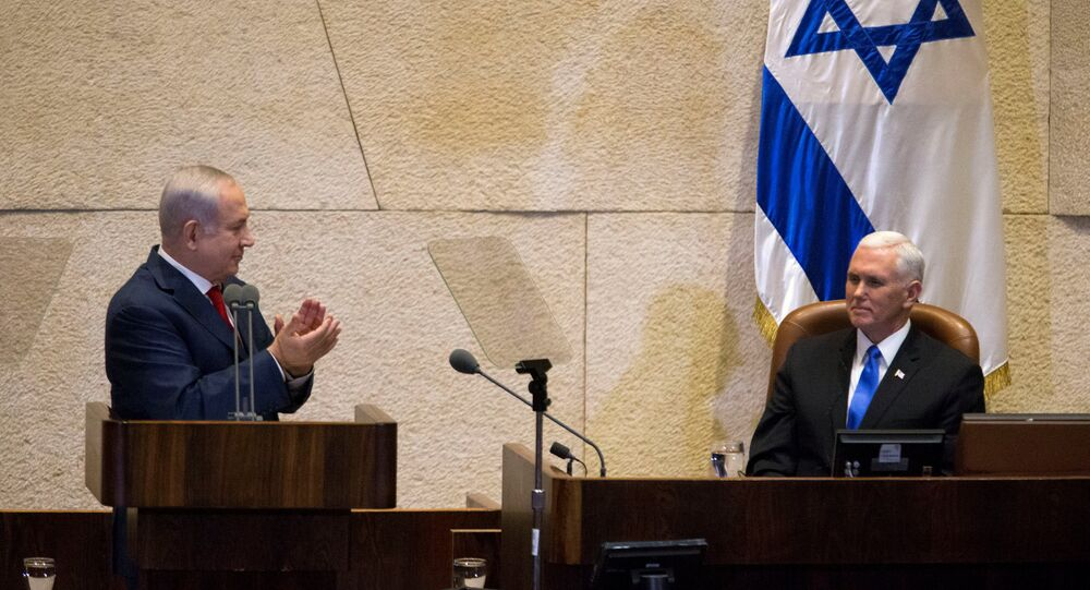 Israeli Prime Minister Benjamin Netanyahu applauds U.S. Vice President Mike Pence ahead of his address to the Knesset, Israeli Parliament, in Jerusalem