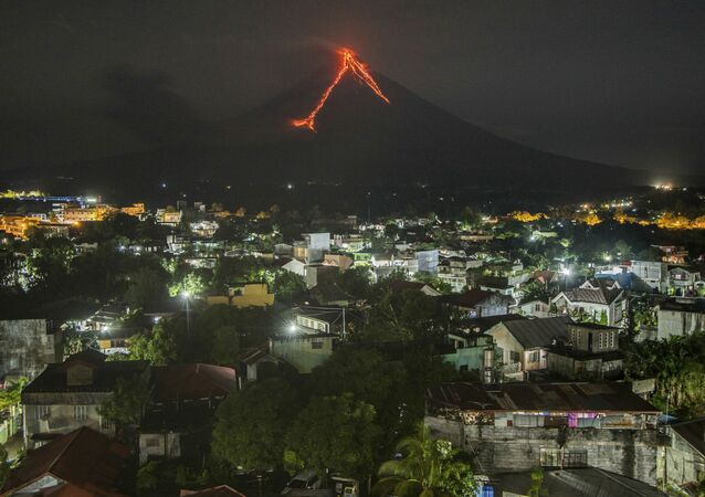 Lava cascades down the slopes of the Mayon volcano seen from Legazpi city, Albay province, 340 kilometers (210 miles) southeast of Manila, Philippines, Tuesday, Jan. 16, 2018