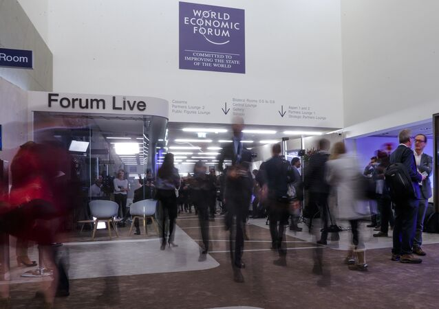 People walk through a corridor on the opening day of the World Economic Forum, WEF, in Davos, Switzerland, Tuesday, Jan. 23, 2018